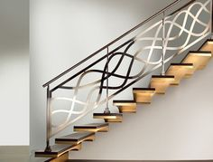 Stainless steel railing and two-tone wing-shaped cantilever stair by #Marretti