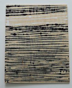 Lari Washburn, drawing on raw wood