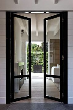 Of all of the new design ideas and trends this year, my favorite by a long shot is the increased use of interior steel doors and windows. Style At Home, Arched Interior Doors, Steel Doors And Windows, Interior Architecture, Interior Design, Interior Modern, Interior Decorating, Decorating Ideas, Patio Doors