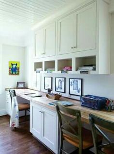 Love this too but would want the cabinets all the way across the wall over the entire length of the desks.