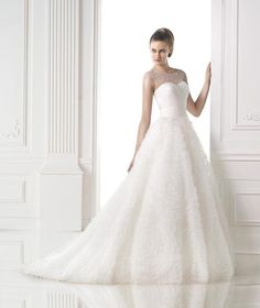 White Lily Couture - Exclusive Bridal by Appointment. Moana-Molly by Pronovias wedding dress.