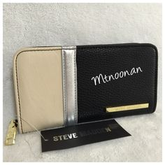 "STEVE MADDEN Color Block Zip Around Wallet NEW WITH TAGS, Authentic STEVE MADDEN Color Block Zip Around Wallet  DETAILS: • Color: Bone / Silver / Black • 6 credit card slots • 2 slip pockets • 1 expandable compartment • 1 zipper compartment • Top / horizontal full length cash slip compartment  • Zip Around closure • Gold tone hardware • 7.5""L x 4""H x 1.5""D   I have more STEVE MADDEN, Check out my other items!  ❌ NO TRADES Steve Madden Bags Wallets"