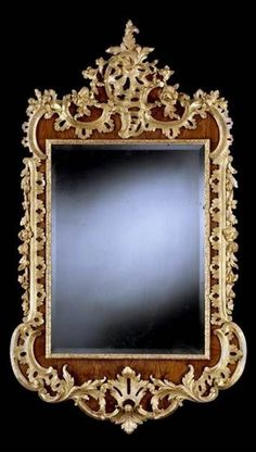 A GEORGE II WALNUT AND PARCEL GILT MIRROR, ca 1745 Height: 5 ft 6 in; 167.5 cm Width: 3 ft 2 in; 96.5 cm