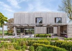 "House in Oxfordshire is covered in oak to create a ""simplified volume""."