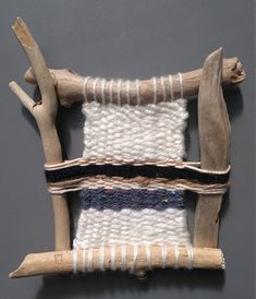 Hand woven wall hanging on a driftwood loom