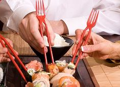 Is the Chork the future of eating? East and West end their dinner-time conflict at last with the invention of the chopstick-fork