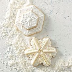 We're baking in a winter wonderland! Create gorgeous snowflake cookies from easy-to-whip-up almond cookie dough and a few simple decorations. Ice and stack them, or bedeck them with chocolate curls and candy pearls -- your choice! /