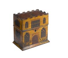 A rare Regency painted tole tea caddy in the form of a house