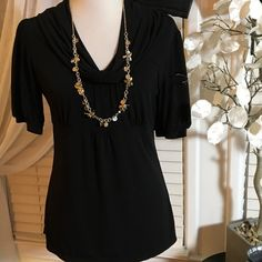 LOFT BLACK TOP Amazing looking top in excellent condition, made of polyester and spandex LOFT Tops Blouses