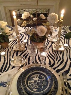 Detail of my zebra table with a Vladimir Kanevsky English Rose centerpiece. Zulu Traditional Wedding, Blue Table Settings, Rose Centerpieces, Candlesticks, Candelabra, Animal Decor, English Roses, Wedding Designs, Home
