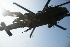 Airman Danielle Trejo, a simulated injury victim, is lifted into a Sikorsky HH-60 Pave Hawk helicopter during exercise Pacific Thunder April 14, 2014, in the Republic of Korea. Pacific Thunder is hosted by Osan Air Base, and features numerous United States and RoK aircraft. (U.S. Air Force photo by Staff Sgt. Jake Barreiro)