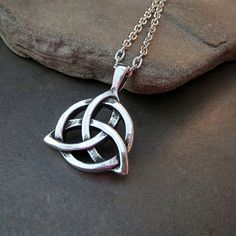 """A detailed antique silver 3D celtic charm suspends from a high quality silver link chain with a matching clasp. Your necklace will come in a nice box tied with a bow!  Measures: 24"""" Pendant: 1"""" x 1 1/4"""""""