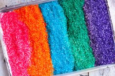 This rainbow rice sensory bin is a fun way for kids to explore textures and colors. Perfect for toddlers or sensory kids, and makes a great homemade gift too!