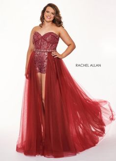 Style 6692 from Rachel Allan Curves is a sweetheart neck strapless lace and tulle plus size evening dress with a sheer long skirt over shorts and embellished waistband.