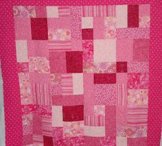 machine quilted for customer by Memories In Stitches, pattern yellow brick road