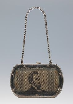 Coin purse, ca. 1909. The Metropolitan Museum of Art, New York. Brooklyn Museum Costume Collection at The Metropolitan Museum of Art, Gift of the Brooklyn Museum, 2009; Gift of Mrs. Louis M. Doup, 1941 (2009.300.1767) | The image of a youthful Lincoln veiled by wire mesh makes this object an arresting and rare fashion-related memento of a towering figure in American history.