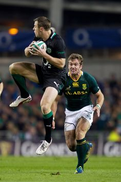 Jaco Taute of South Africa and Tommy Bowe of Ireland in action during the International rugby match between Ireland and South Africa in the Aviva Stadium on November 10, 2012 in Dublin, Ireland.