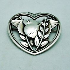 """GEORG JENSEN BROOCH # 239, STERLING SILVER. DESIGNED BY ARNO MALINOWSKI $550.00 Condition: fine vintage, preowned Year: after 1945 Size:1 3/4"""" by 1 3/4""""  Inv. #: 102113218.95"""