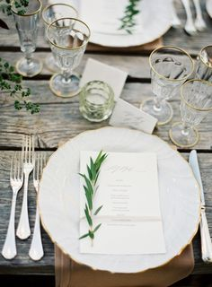 Gold rimmed plates, silverware and glasses are the perfect touch to a rustic wedding. #millerspartyrental #rusticwedding #goldrimmeddishware
