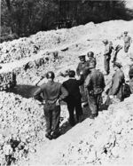 American generals touring Ohrdruf Concentration Camp, Gotha, Germany, 12 Apr 1945, photo 2 of 2