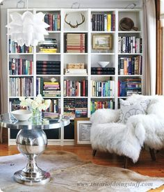 Library: Even if you have a lot of books, alternate their position between laying horizontal and vertical, then add accessories throughout – via The Art of Doing Stuff.