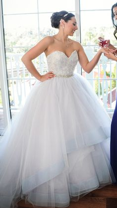 Petite plus size wedding dresses with a ball gown skirt fit for a princess. This strapless wedding gown has a beaded sweetheart bodice and a rhinestone belt at the natural waist. Find other plus size wedding dress options at www.dariuscordell.com