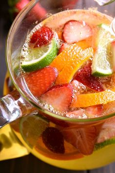 This Skinny Sparkling Sangria is the ULTIMATE summer cocktail! Loaded with fruit and packed with flavor, this sparkling sangria is sweet, refreshing, and perfect for summer!