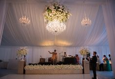 Elevant Band or DJ ~ For guests to truly interact with musician(s), highlight DJ or band that is playing. The band set up on a stage elevated right in front of and above the dance floor (with sparkly lining and lots of flowers) gives extra appeal.