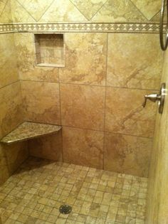 Imagine a shower with no doors or curtain to clean! Walk in shower with stone border, seat and nook. Located in Hudson, Ohio