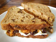 CARROT CAKE SANDWICH:  1/2 cup finely shredded or grated carrots, preferably organic  2 tsp pure maple syrup, divided  2 Tbsp light whipped cream cheese, (or neufchatel), at room temperature  1/4 tsp ground cinnamon  1/8 tsp ground ginger  1/8 tsp ground nutmeg  2 slices whole wheat cinnamon raisin bread  2 Tbsp chopped walnuts, toasted  2 Tbsp raisins