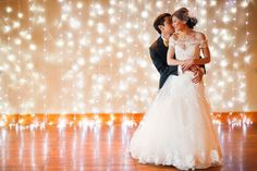 Creating a stunning photo backdrop is as simple as hanging a few strands of twinkling lights.