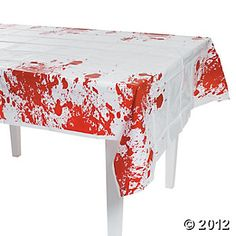Zombie Party Table Cover: easy to make with white table cloths and red paint!