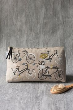 Bicicletta Large Cosmetic Bag - A large cosmetic bag made from linen is perfect for storing your beauty essentials, accessories, toiletries and more. Whimsical bicycles cruise along cobblestone streets, carrying baskets of florals and picnic essentials. Picnic Essentials, Beauty Essentials, Large Cosmetic Bag, Travel Toiletries, Cat Design, Large Bags, Zipper Pouch, Travel Style, Bag Making