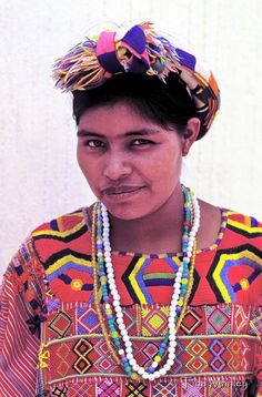 GUATEMALA, BELLAVISTA:  Beautiful young Mam woman in traditional dress  waits to be seen by doctors in a medical clinic in her remote village in the Northwestern Highlands of Guatemala.