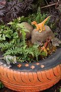 Dinasaur tyre garden. So easy to make and really sets the scene for some quality imaginative play.