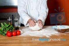 """Chef Preparing Pizza Base, Cropped Image"" by stockimages at FreeDigitalPhotos.net"