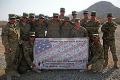 They got our banner!! The 510th Clearance Company, 20th Engineer Battalion, sent us this pic from Afghanistan -- posing with the banner we sent them. They said they enjoyed reading all the messages from Littles, Bigs, parents and staff, thanking them for their service – and they'll be displaying it in their recreation area so all soldiers can check it out!