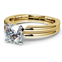 A single precious diamond is a romantic thing, indeed... Propose with the Rocker Migraine Diamond Solitaire Ring in Yellow Gold! Its simple, refined design is ideal for the bride who loves sparkle, but doesn't want to be too flashy!  http://www.brilliance.com/engagement-rings/rocker-milgrain-solitaire-ring-platinum