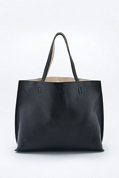 Reversible Vegan Leather Oversized Tote Bag in Black and Ivory - Urban Outfitters