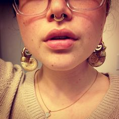 Gold or rose gold tribal or bead style septum ring.