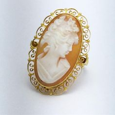 Gold cameo ring with detailed filigree halo.  Most people visiting the store who are drawn to cameos tell me they're collectors- if you love them, it's hard not to be. Each one is unique and different. 🎀 . . . . . #cameo #cameojewelry #vintage #vintagering #vintagecameo #vintagecollection #jewelry #jewelrycollector #jewelrycollection #ring #ringcollection #antique #antiquecameo #antiques #antiquejewelry #jewelrylover #cameocollector #cameocollection #retro #filigree #filigreejewelry…