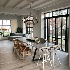 Dining space with large windows | Valerie Aflalo