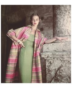 Jean Patchett wears a plaid Siam coat over a silk dress, both by Tina Leser, in a photograph taken in Havana in 1950 Photo Clifford Coffin Condè Nast