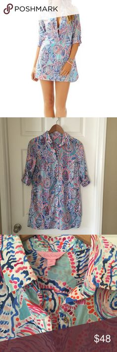 Lilly Pulitzer Jupiter Island seashell tunic Lilly Pulitzer Jupiter Island tunic. Aqua blue with multicolor bright seashell print. Very versatile piece that can be worn as beach cover up, dress, or tunic top. Collared button down with gold buttons. Sleeves roll and button. Two side pockets at hips. Size XS. In excellent condition. Lilly Pulitzer Tops Tunics