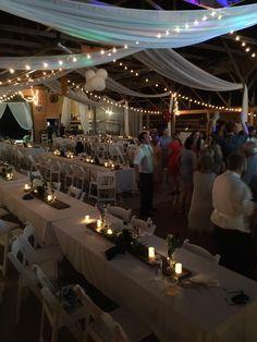 Indoor Wedding with #jamestownawning #whitechairs #weddingrentals
