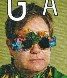 POP Magazine S/S 2011 Sir Elton John wears Mercura    In this photo: Sir Elton John, Adam Broomberg & Oliver Chanarin photos, Yohji Yamamoto shirt, Loree Rodkiin gold rings, Vanessa Reid Fashion, Prada scarf, Theo Fennell earring, Mercura NYC surreal rose sunglasses with garden for Mercura Sunglasses eyewear, POP Magazine cover story