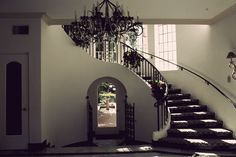 pretty gothic entryway. Love the staircase