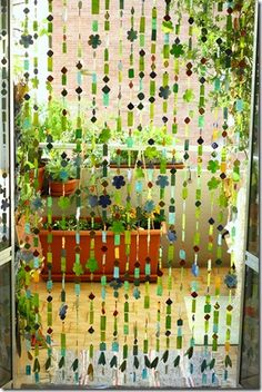 Chain fly screens curtain made with many paper cards and hand-colored cardboard (from the container of eggs) with a strand of nylon.