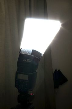 flashDiffuser:  I have made one of these and it works quite well.  Packs flat in the camera bag is a bonus!