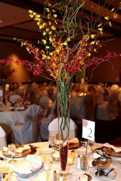 Love these tall centerpieces   Just an idea like all the rest that I have been posting :)